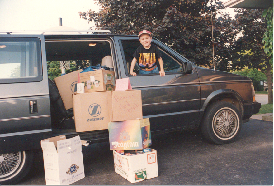 boy in van surrounded by boxes